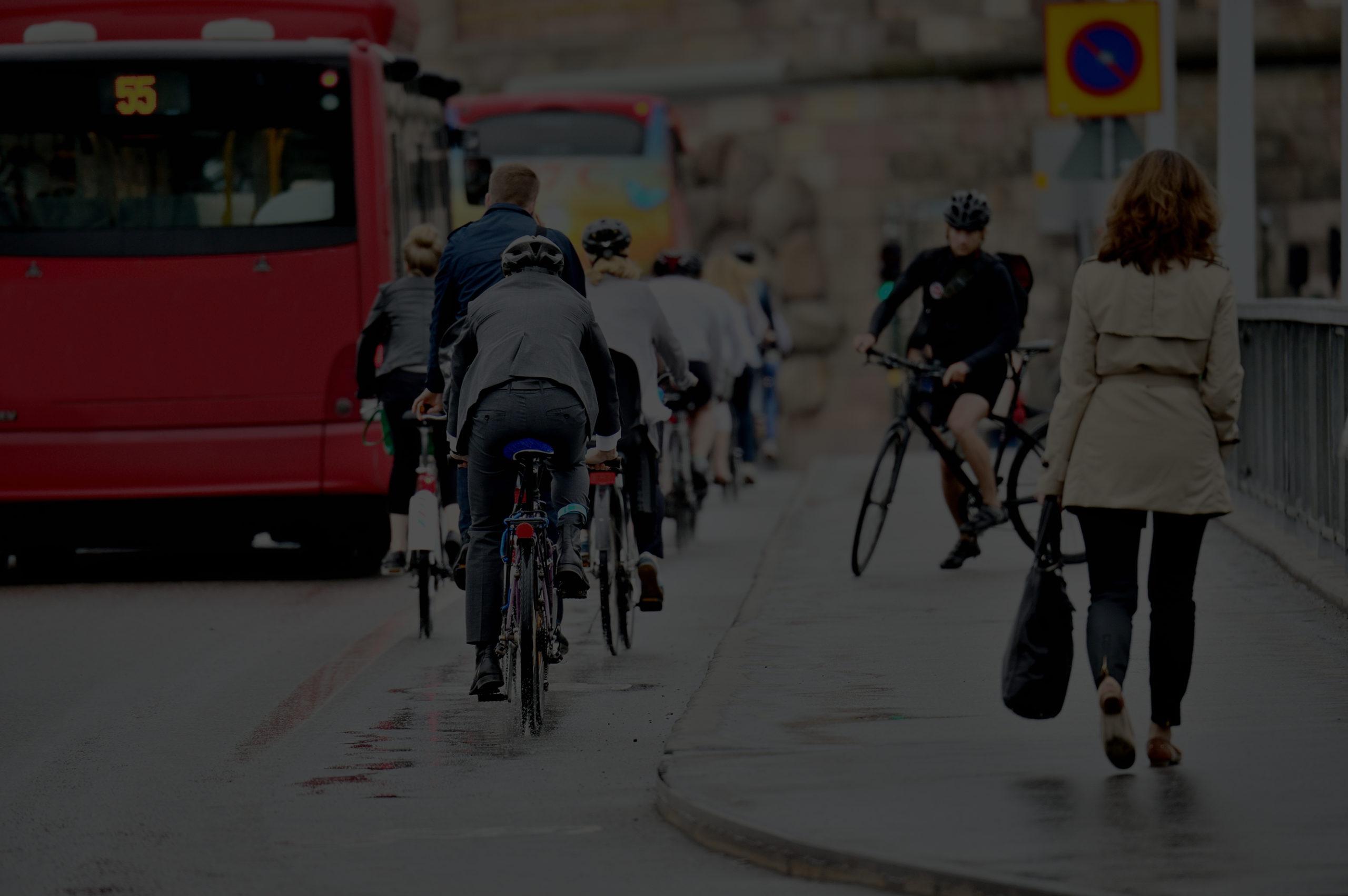 cyclists near red london bus using AVAS