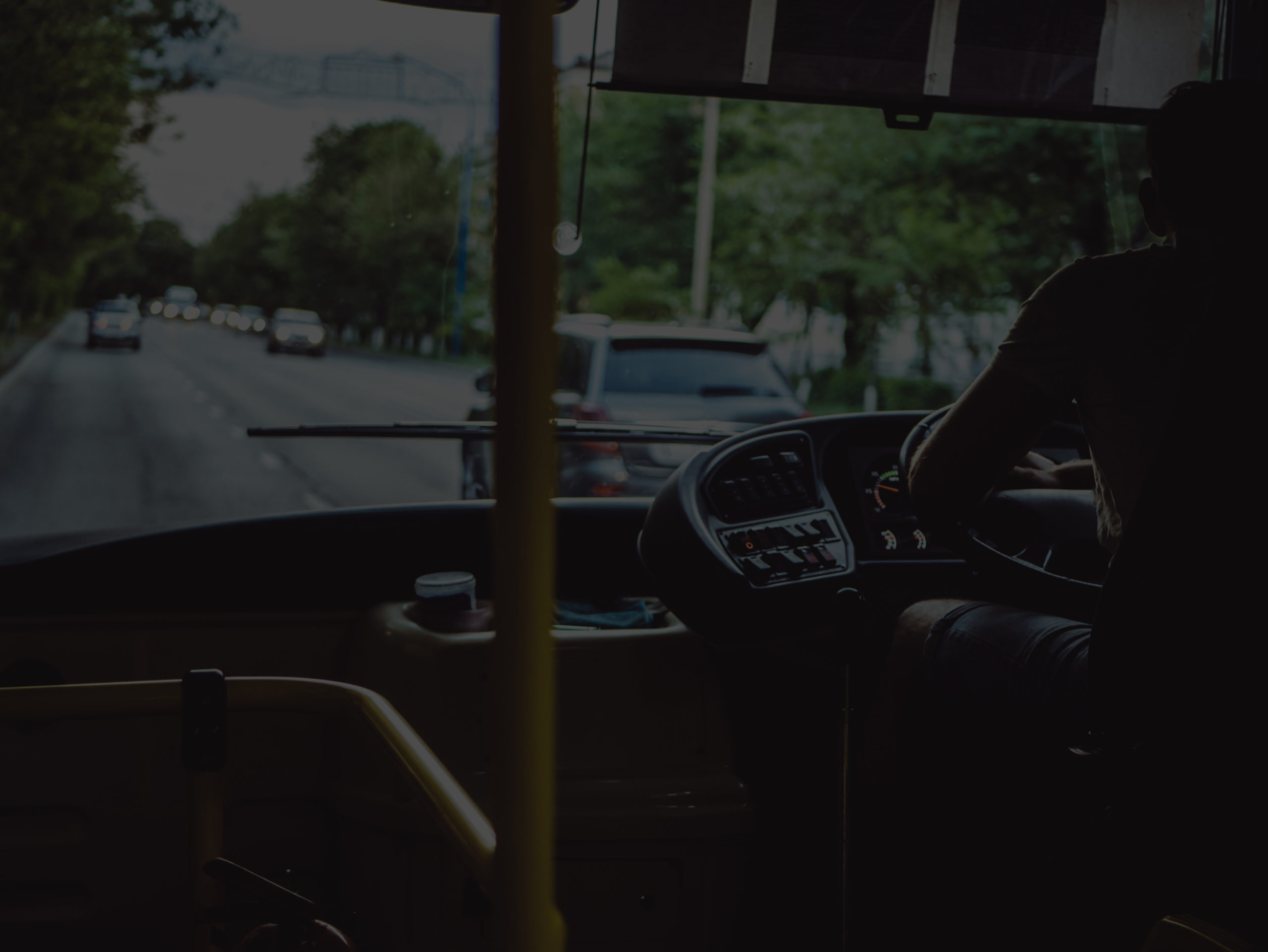 Inside of bus showing drivers cab